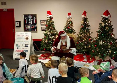 Santa Dan Reading To A Classroom