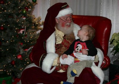 Santa Dan Being Goofy With An Infant