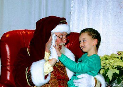 Santa Dan High Fiving A Child