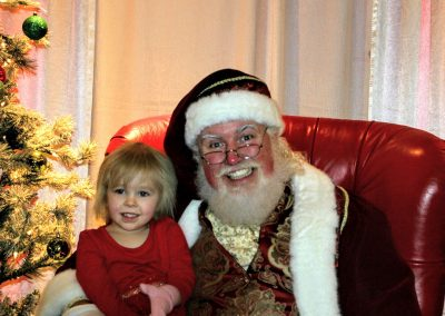 Santa Dan Showing His BIG Smile With A Child