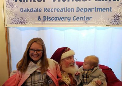 Santa Dan Picture With Infant & Pre-Teen at The Oakdale Winter Wonderland