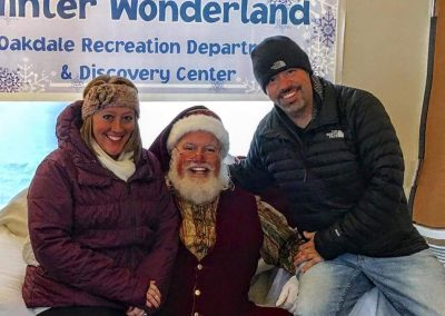 Santa Dan Picture With Parents at The Oakdale Winter Wonderland