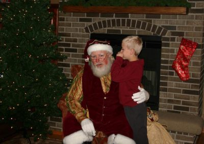 Santa Dan Listening To A Child Whisper In His Ear