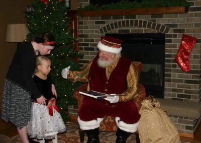Santa Dan & Skeptical Looking Young Lady