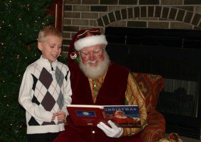 Santa Dan Reading To Young Boy