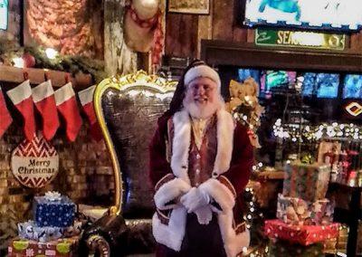 Santa Dan Posing With Presents
