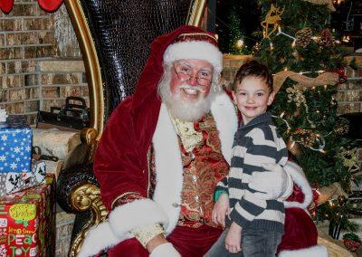 Santa Dan & Young Boy Smiling For The Camera