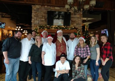 Santa Dan Group Photo With Restaurant Employees