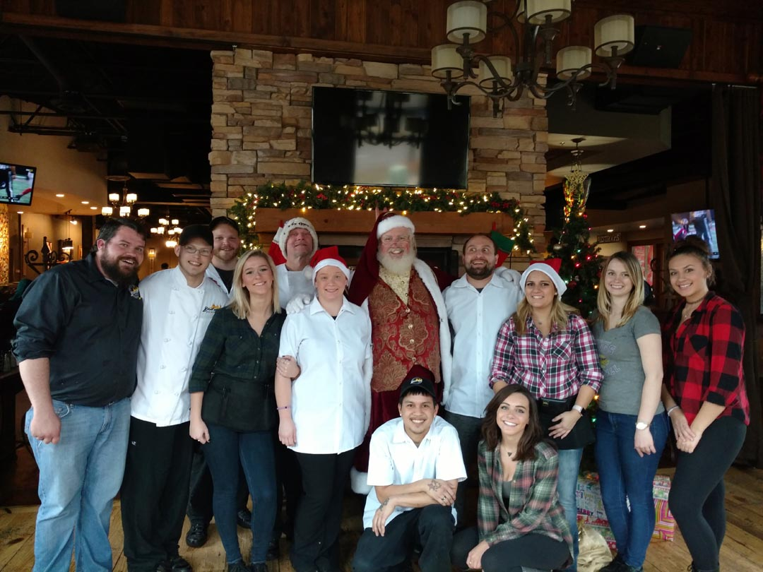 Santa Dan Group Photo With Restaurant Employees For Corporate Event