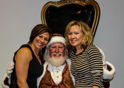 Santa Dan & Two Ladies Smiling